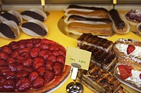Pastries displayed in a shop window in the Dordogne region of France