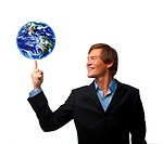 Conceptual image of a businessman with the world at his fingertips
