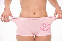 young woman in too wide pink pants dieting