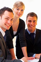 Three white_collar workers conducting business