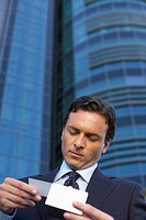 Businessman watching a business card
