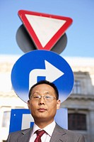 Businessman in front of a traffic sign