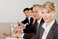 Four businesspeople in conference room, Bavaria, Germany
