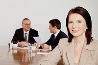 Three businesspeople in conference room, Bavaria, Germany
