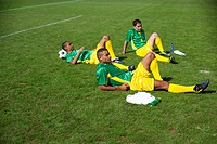 Brazilian kickers lying on grass