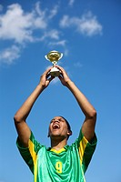 Brazilian soccer player holding up a cup