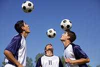 Soccer players heading balls