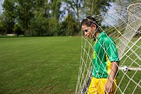 Brazilian soccer player standing in goal net