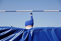 Woman making high jump (thumbnail)