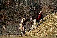 Mature couple walking up a hill