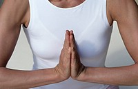 Woman pressing the Palms of her Hands against each other _ Stretching _ Yoga