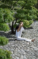 Woman touches one Foot and stretching upwards _ Yoga _ Trees _ Nature