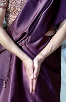 Woman bringing the Palms of her Hands together over her Lap _ Prayer _ Tradition