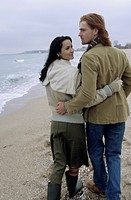 Young brownhaired Woman going for a Walk at the Beach with her Boyfriend _ Happiness _ Togetherness _ Holiday _ Season _ Winter