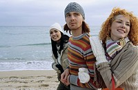 Three Friends strolling along the Beach Arm in Arm - Fun - Together - Trip (thumbnail)