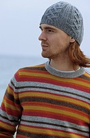 Middle_aged Man with woolen Hat and striped Jumper _ Winterly Clothing
