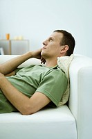 Man daydreaming on sofa