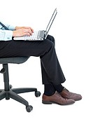 Business man sitting on a chair and working on a laptop isolated on white background