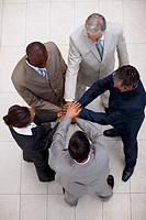 Top view: Team of business colleagues with their hands together in unity