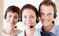 Happy young group of call centre employee´s