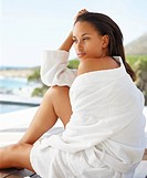 Sweet young woman in a bath robe enjoying her vacation