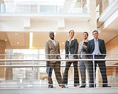 Portrait of business colleagues standing by a railing