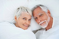 Cute senior couple enjoying themselves in bed