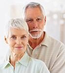 Portrait of a cute old senior couple smiling confidently