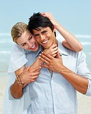 Happy young couple in love enjoying at the beach