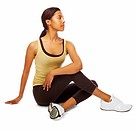 Young toned woman doing fitness exercises an looking at copyspace