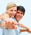 Closeup portrait of a young man and his girlfriend stretching their hands together