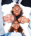 Upward view of business colleagues with their heads together on a white background