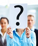 Closeup portrait of businesspeople holding question mark on boards