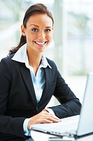 Businesswoman in formals smiling and portraying towards camera