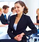 Confident young attractive business woman in a meeting