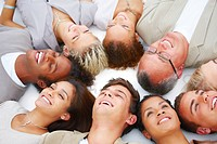 Closeup portrait of happy group of friends lying in circle isolated on white