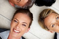 Cropped image of successful team of business people lying on the floor, closeup