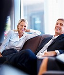Portrait of satisfied business partners laughing during conversation