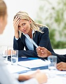 Upset young business woman during a meeting