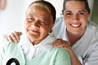Senior woman with a nurse smiling together