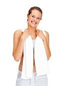 Portrait of a happy young woman holding a towel around her neck isolated on white