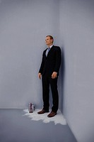 Full length of a business man standing trapped at the corner of a fresh painted floor