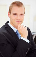 Portrait of a handsome young business man in black suit, isolated