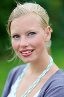 Closeup portrait of a cute young female smiling isolated outdoors