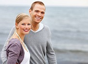 Portrait of a happy young couple spending a pleasant time by the beach together