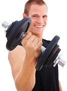 Happy young man using a dumbbell to exercise, focus on the dumbbell