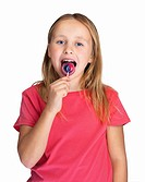 Happy Caucasian girl eating a lollipop isolated on white