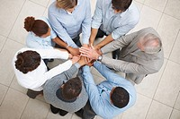 Unity _ Top view of business people with their hands together in a circle