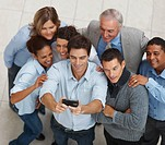 Top view of multi ethnic business people posing for a self team photograph