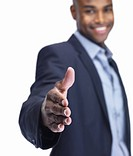 Portrait of a happy young business man offering a handshake for a deal on white background